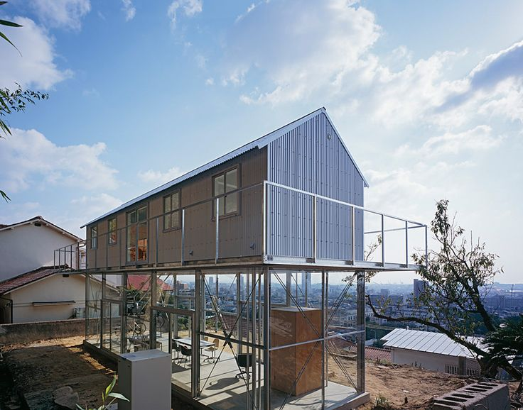 HOUSE IN ROKKO/ by Tato Architects/ Yo Shimada/ Kobe/ Japan/ image © ken'ichi suzuki/ Positioned on mt. rokko, with commanding views overlooking kobe, japan, the 'house in rokko' by japanese architect yo shimada   of tato architects confirms an exploration of minimizing physical impacts upon the environment while maintaining vistas for residents. The site's location along the steep slope eliminated the possibility of using heavy machinery to drive piles.