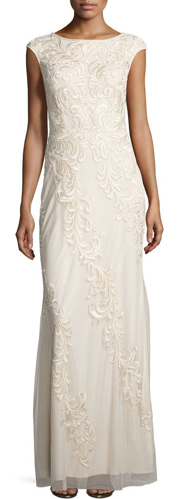 Sleeveless embroidered mesh column gown by Aidan Mattox. Aidan Mattox mesh gown, featuring beaded, acanthus scroll leaf embroidery. Round neckline; V'd back. Sleeveless; slig...