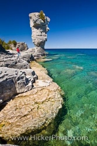 ..Flowerpot Island Rock Formations Lake Huron Ontario    Many tourists cross the waters of Lake Huron in Ontario, Canada to explore Flowerpot Island where these rock formations, or sea stacks, have formed..