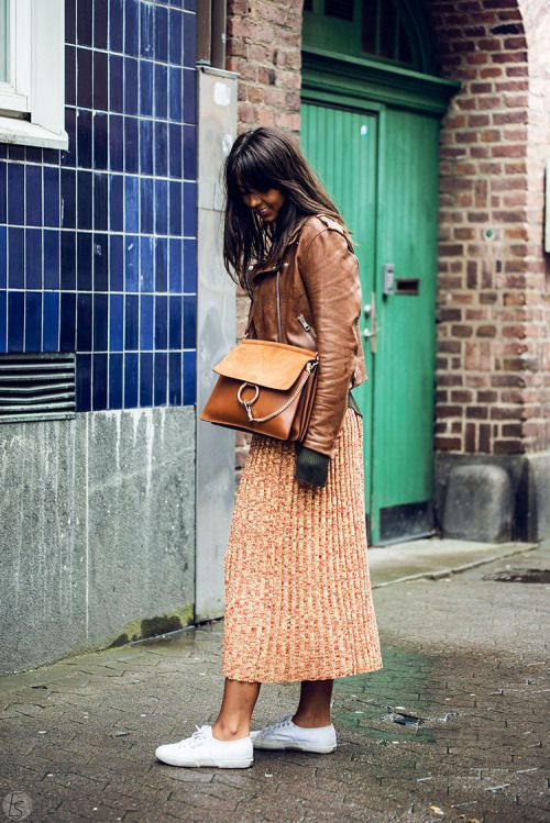 Can this be any better? Brown leather jacket. pleated light brown skirt, white sneakers