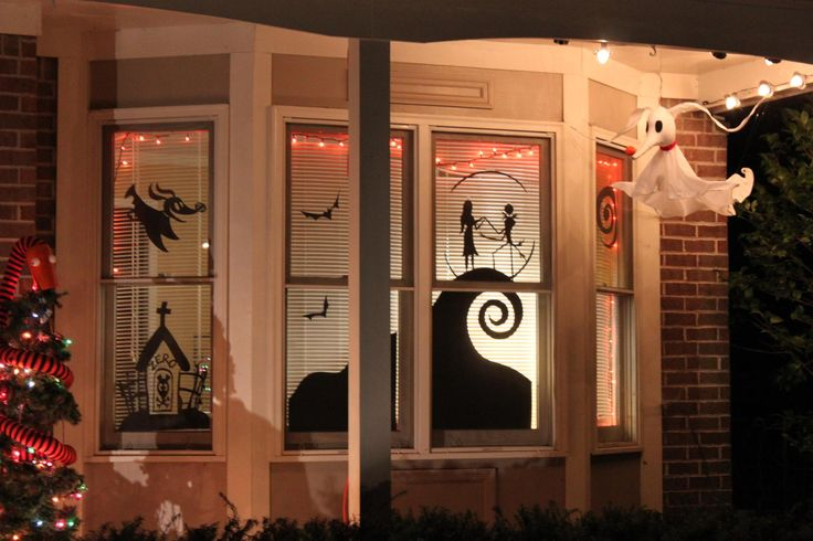Nightmare Before Christmas....Cut-outs taped to the window with a dollar store orange tablecloth hanging from the window.