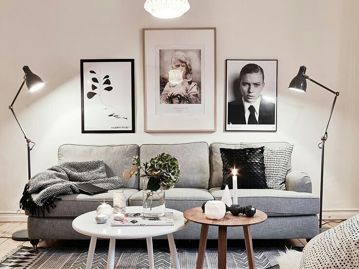 Grey sofa, white & wooden coffee table.
