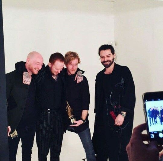 No doubt the finger will fall off this award later like it has done every previous time, but that's part of the fun - we play 'find the finger'! Simon Neil