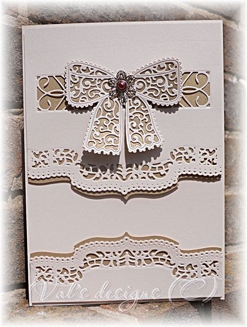 On pearlised ivory card. Dies are tattered lace bow, Spellbinders brackets borders, and Cheery Lynn Lucien tile