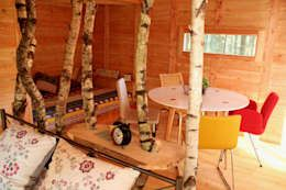 Hoteles de estilo  por Cabañas en los árboles