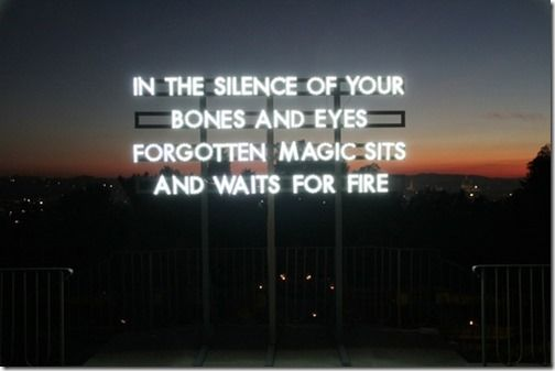 'in the silence of your bones and eyes, forgotten magic sits and waits for fire' by artist Robert Montgomery - neon