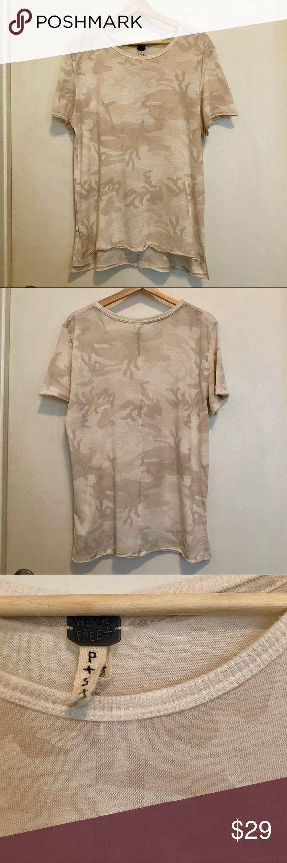 Free People Neutral Camo Tee Camo is the new white staple shirt! This great neutral camo tee is perfect paired with jeans or tucked in to a pencil skirt. Only worn a few times and in perfect condition! Free People Tops Tees - Short Sleeve