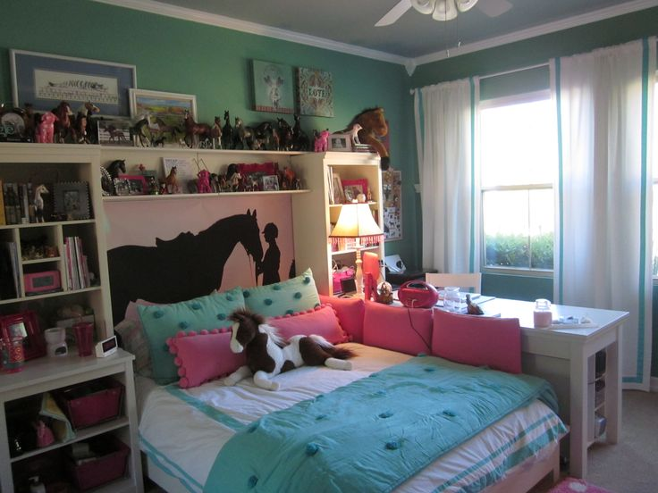 this fun horse themed bedroom has lots of storage and