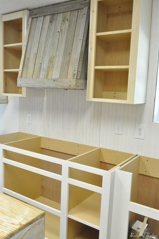 Want this vent hood made from picket fence boards!...courtesy of Buckets of Burlap Blog