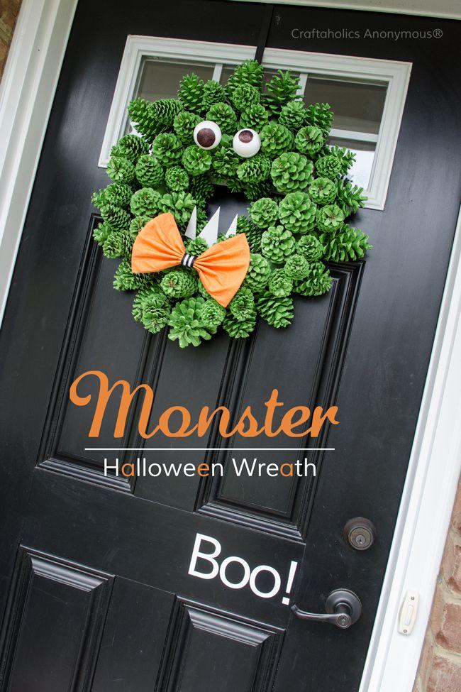 Pinecone monster Halloween Wreath idea. Super cute and easy DIY wreath!