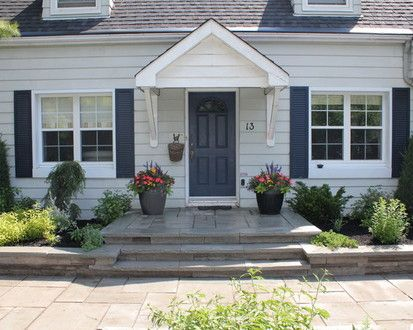Exterior Doors | blue front door with matching shutters on a white house | Bayer Built Woodworks