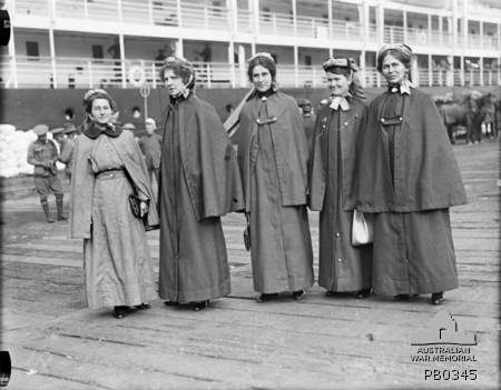 Wearing Outdoor dress. Nurses prior to boarding HMAT Orsova (A67). Identified are (left to right): Sister Mary Florence Kitson; Staff Nurse Victoria Dorothy Christenson; unidentified; possibly Staff Nurse Annie McHardy; unidentified.