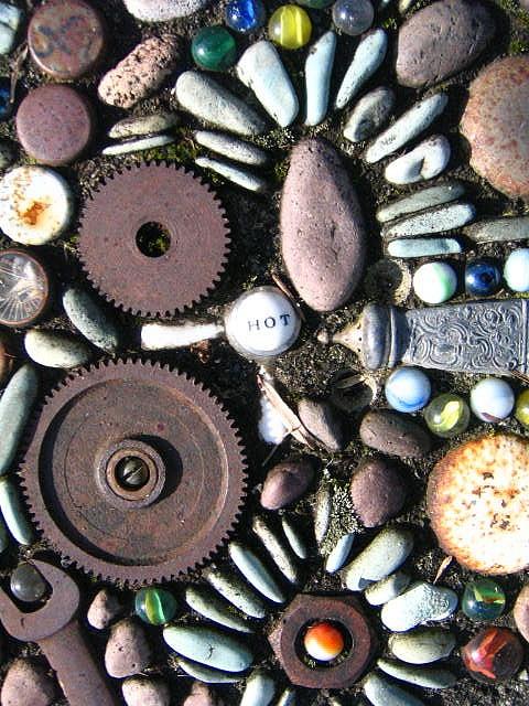 sidewalk mosaic:  via Rozanne on Flickr