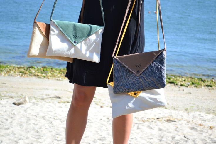 Le sac Lys  Elégant et tellement pratique, le sac Lys allie avec raffinement la voile recyclée et le cuir coloré. Un travail minutieux pour ce sac enveloppe dont la fabrication est 100% française unique et authentique.