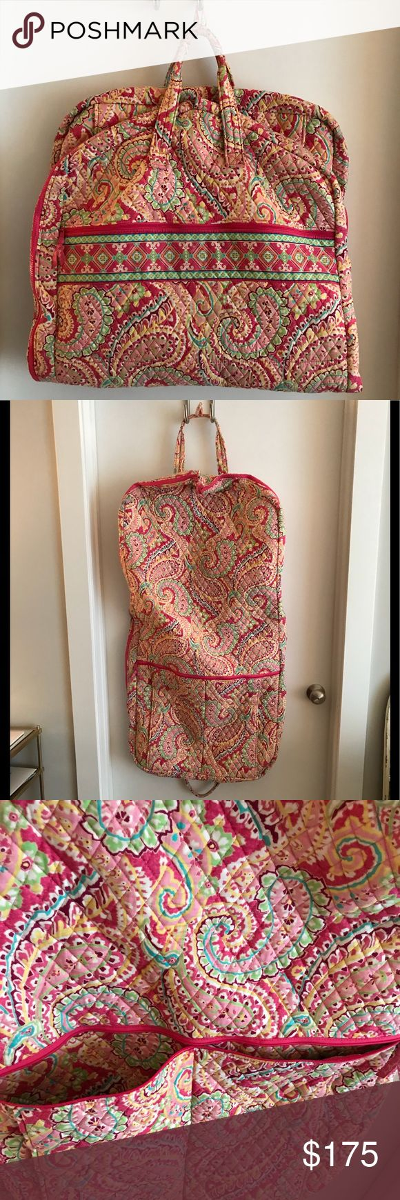 Vera Bradley garment bag Vera Bradley garment bag in a pink print.  Has 3 additional compartments, spacious main compartment can hold multiple garments, and folds to carry with handles or hang.excellent condition! Vera Bradley Bags Travel Bags