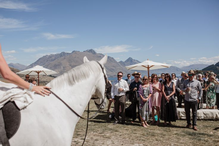 Bride arrives on horse back at NZ High Country wedding venue Queenstown New Zealand