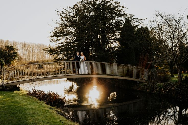 I love golden hour before the sun sets and there's something particularly magical about this reflection in the @caswellhouse moat. Photo by Benjamin Stuart Photography #weddingphotography #goldenhour #naturallight #caswellhouse #brideandgroom #couplephoto #weddingday
