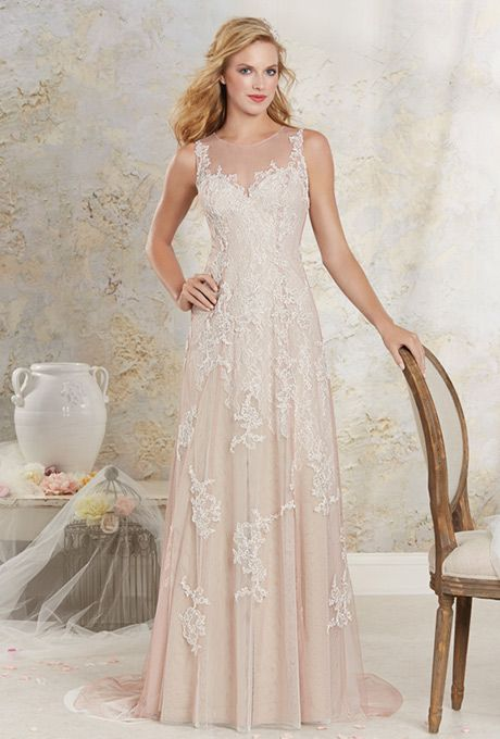 Modern Vintage by Alfred Angelo. Soft A-line gown with an all over lace underlay and multi layered soft net overlay. Delicate re-embroidered lace appliqu�s adorns the dress throughout and accents the fitted body, sheer illusion neckline, and chapel length train.