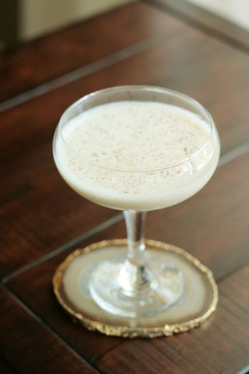 Brandy Alexander:    1 1/2 oz. Brandy  1 oz. Dark Creme de Cacao  1 oz. Half-and-Half  1/4 tsp. Ground Nutmeg