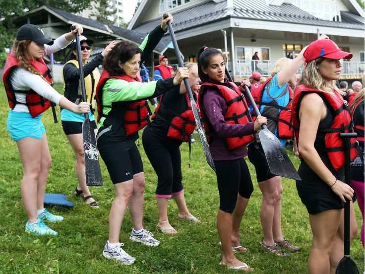 Jennifer Hooper, in green jacket, second from left, team captain of the Brain Wave dragon boat team representing the Brain Injury Association of Canada, in dry land rehearsals.