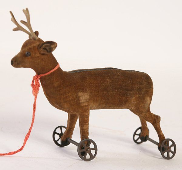 """EARLY STEIFF FELT DEER ON WHEELS Sold For $ 1,000  Early 20th Century deer pull toy on iron wheels. Unmarked.  5"""" high x 8"""" wide.                            Condition report           Good condition"""