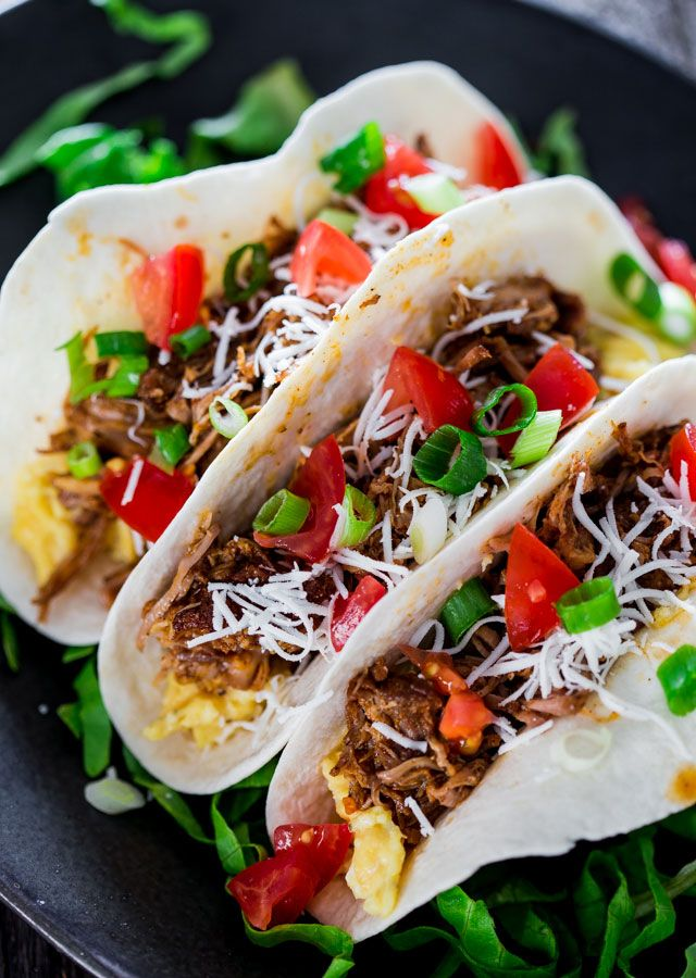 Breakfast Beer Braised Pork Tacos - This delicious slowly braised pork shoulder in beer and chicken broth gives you the most succulent spiced pork that's perfect for making incredible breakfast tacos.