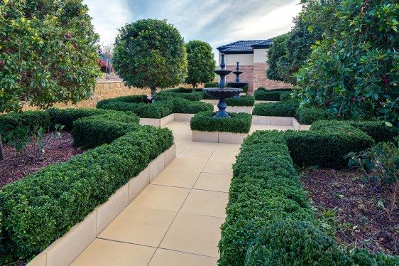 Formal Front Garden of Lilly Pillys and Hedges, David Austin Roses, Large Pavers and beautiful Fountains, For Sale at 559 Flatrock Road, Beechworth Vic 3747.