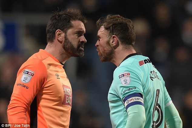Derby goalkeeper Scott Carson exchanges words with his team-mate Richard Keogh
