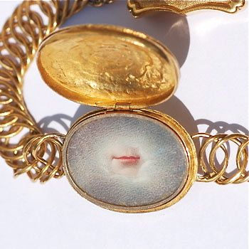 Lover's Mouth: Georgian high carat gold bracelet circa 1820, the central compartment enclosing a watercolour on ivory miniature of a lover's mouth. Georgian lover's eye portraits are relatively scarce and this is only the second example I have seen of a lover's mouth. The lid of the compartment is engraved with a rose, indicating that the subject within is sub rosa, i.e. it is secret, confidential and not to be discussed. A superb piece redolent with symbolism.