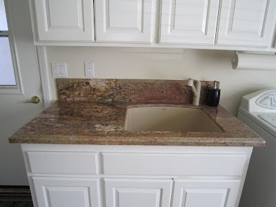 Laundry Room Vanity With 6 Inch Ogee Backsplash, Undermount Laundry Sink,  And Ogee To Square Edge Profile. In Crema Bordeaux Granite.