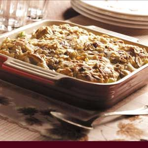Crescent-Topped Turkey Amandine Recipe -Quick to prepare, this tasty main dish is loaded with turkey flavor and a nice crunch from celery and water chestnuts. Topped with a golden crescent roll crust and a sprinkling of almonds and cheese, it's bound to become a favorite. —Becky Larson, Mallard, Iowa