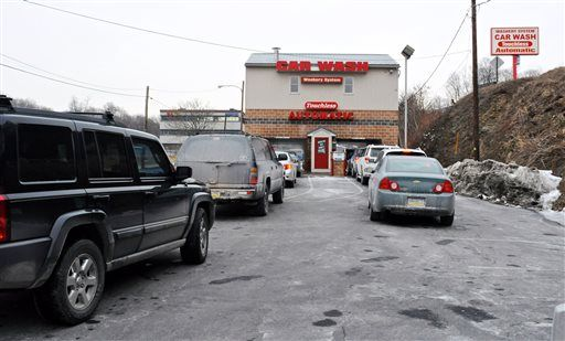 As temperatures rise, cars line up for a car wash at the Washery System Touchless Automatic Car Wash on Terry Reiley Way in Pottsville, Pa., in this Jan. 31, 2014 file photo. (AP Photo/Republican-Herald, Jacqueline Dormer, File)