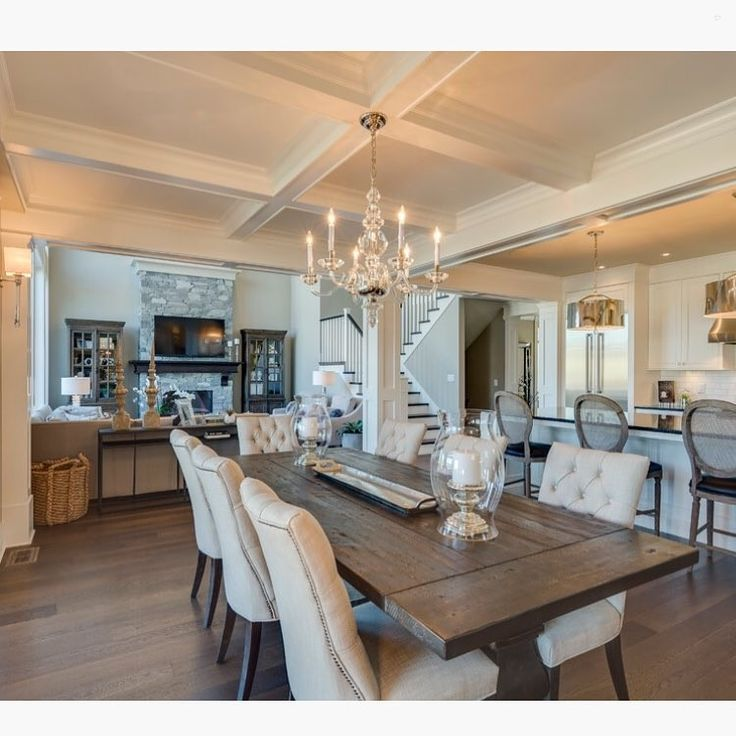 This White Contemporary Dining Room Has An Elegant Coffered Ceiling And Plush  Dining Chairs That Are Paired With A Rustic Hardwood Dining Table For A ...