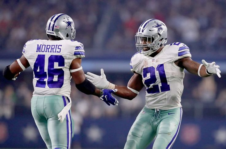 ARLINGTON, TX - SEPTEMBER 25: Ezekiel Elliott #21 of the Dallas Cowboys celebrates with Alfred Morris #46 of the Dallas Cowboys after Morris scored against the Chicago Bears in the second quarter at AT&T Stadium on September 25, 2016 in Arlington, Texas. (Photo by Tom Pennington/Getty Images)