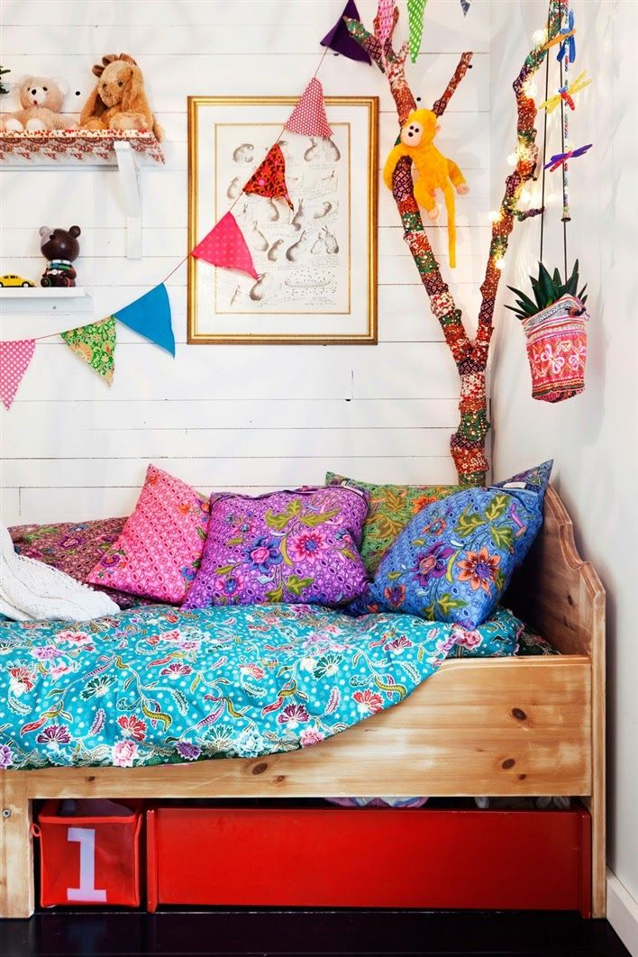 Adorable kids room. Love the yarn bombed tree branch.