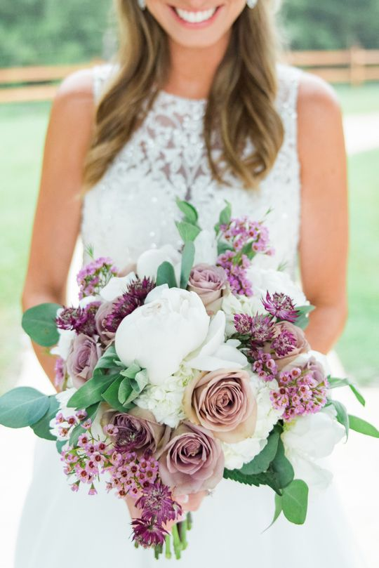 Gorgeous lavender + white bouquet!  Love the different tones of lavender mixed in.  SO beautiful!  Taken at THE SPRINGS Event Venue.  Book your free tour today!