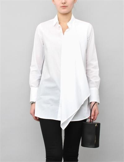 Y's I-Drape Cloth Shirt- White Y's by Yohji Yamamoto Cloth Shirt is a long sleeve cotton blouse featuring small pointed collar, concealed button-down closure at centre front, drapey overlap panel at front, buttoned cuffs and rounded hem. Made in Japan.