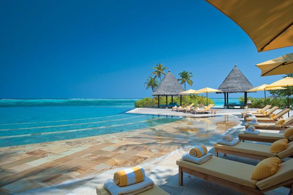 Steps that take you right into the ocean...yes, please. Four Seasons Maldives