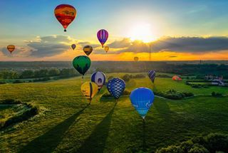 'Towards the Sun' a colorful sunrise filled with hot air ballons