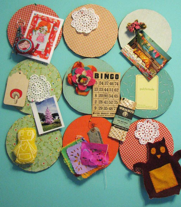 Fabric covered cork boards - I'd do regular square ones I think.  Time to search the interwebs for some new fabric!