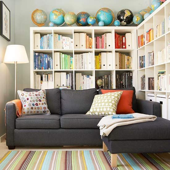 love the idea of pulling the sofa forward and adding bookcases behind it . Great idea for a small space!