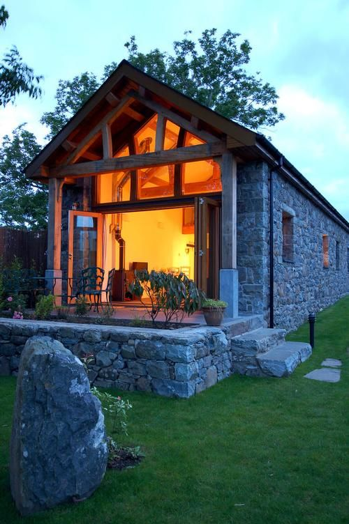 Beautiful tiny stone house. Look at those wood beams and all those windows. Stone barn conversion in Wales available for vacation rentals