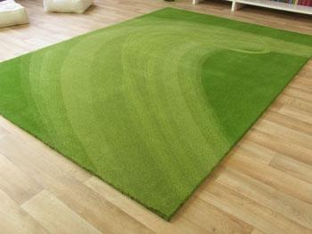 Moderner Designer Teppich Savona Komet handgetufet grün