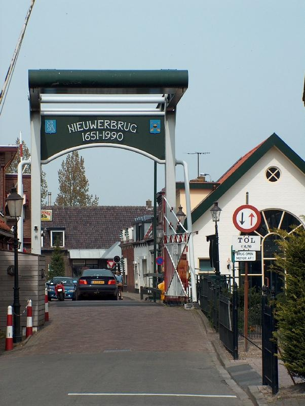 Toll brigde of Nieuwerbrug.  This toll bridge is a moving bridge, it was built in 1651 to facilitate the trade between Woerden and Bodegraven. A little village established itself around the bridge. Nieuwerbrug means new bridge. It is the only toll bridge in the Netherlands. It costs € 1,00 to pass, but only if the bridge master is there.