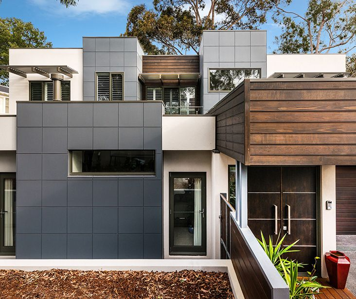 This award-winning Blackburn residence by Solar Solutions Design uses Hebel external wall PowerPanels, with bold rendered finishes and dark timbers. www.hebel.com.au