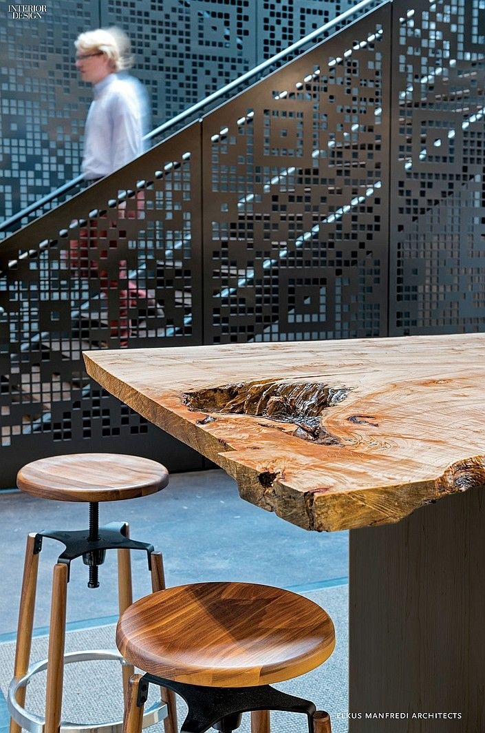 Modern Furniture // Maple slab tops a custom bar-height table in the employee cafe at WS development. Photo by Jasper Sanidad. Space by Elkus Manfredi Architects