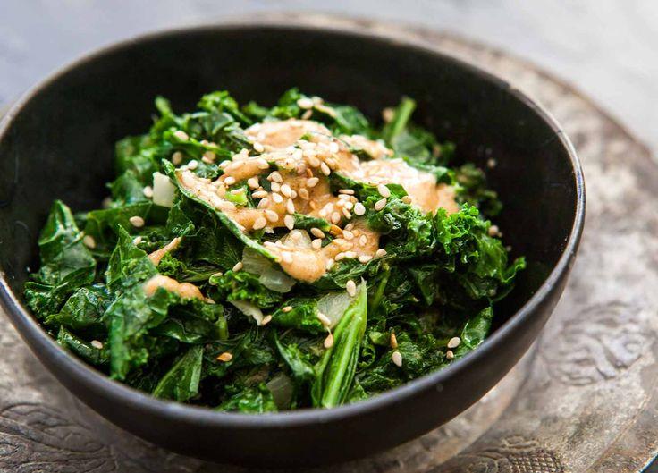 Sautéed Kale with Tahini Sauce ~ Chopped kale sautéed with onions and garlic, mixed with a sauce of sesame tahini, sesame oil, lemon juice, and salt. ~ SimplyRecipes.com