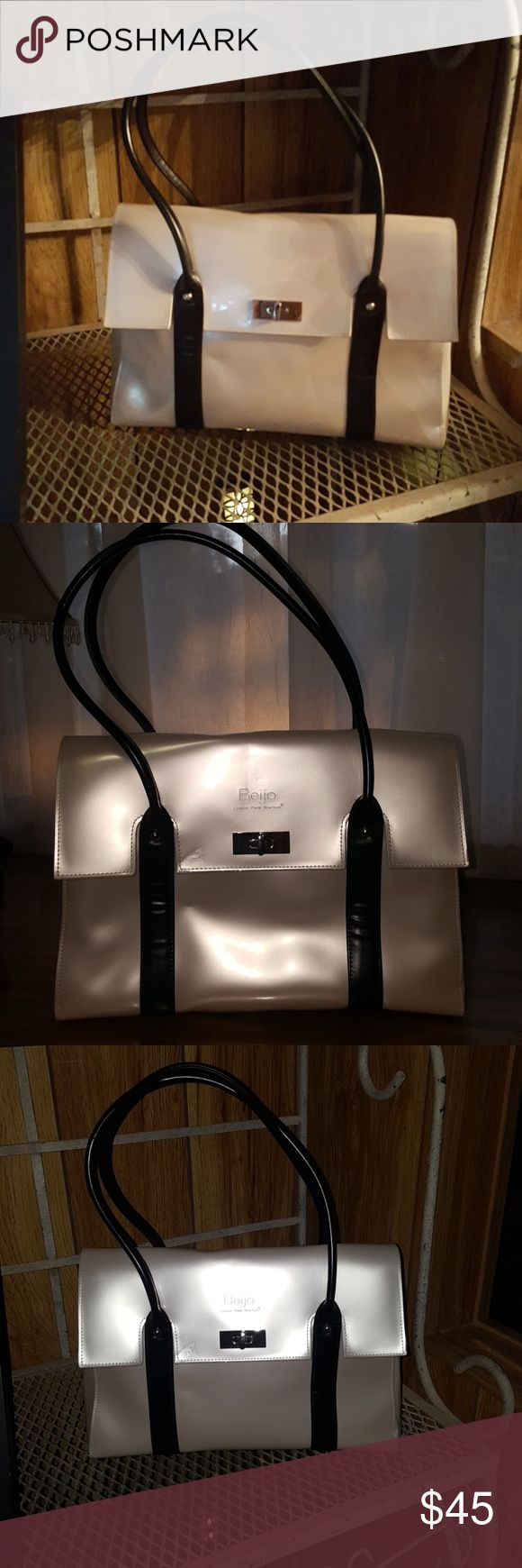 Beijo Purse Pearlescent & Black Purse exude the Luxe Look. Clean  inside & out. Minor impression if front flap. Otherwise Excellent Like New Condition. Roomy inside w/3 sections. Middle has 2 pouches & zippered pocket w/Beijo black label. 🥂Holiday Party ready.🍾🍸🍷 Beijo Bags
