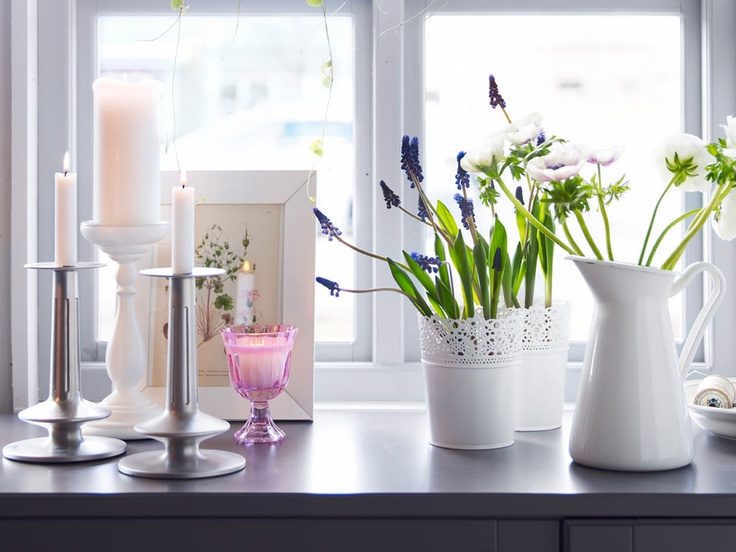 Lighten things up    Add a light and airy feeling to your room with white, powdered steel lacy pots and hanging planters. Use candles and wall sconce candle holders to add warm touches. Always stay safe with candles.