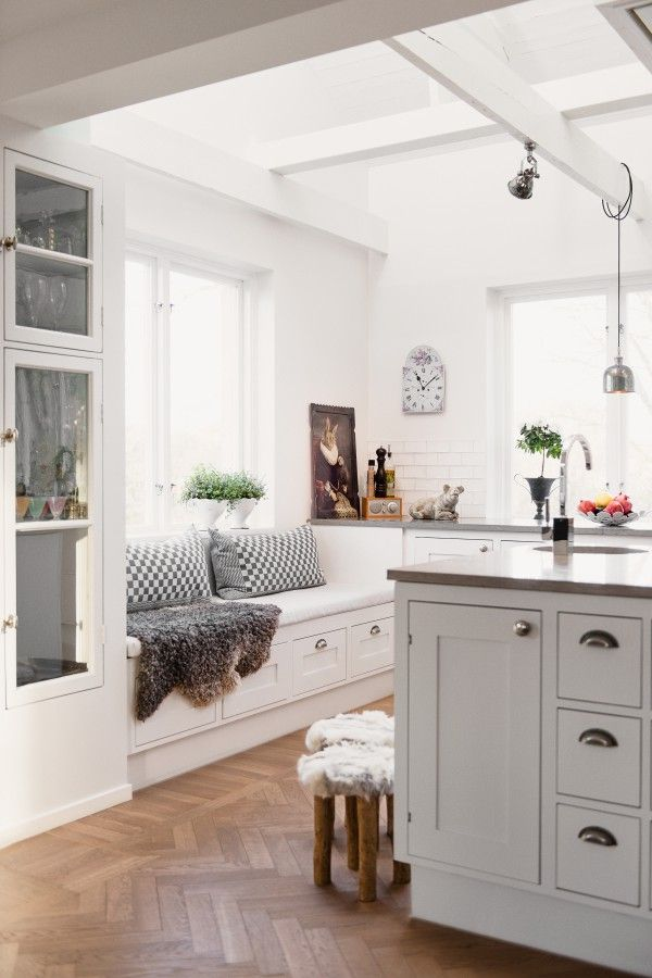 white and gray kitchen cabinets, white tile walls and white ceiling beams